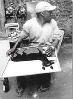 Edward Saidi Tingatinga at his studio